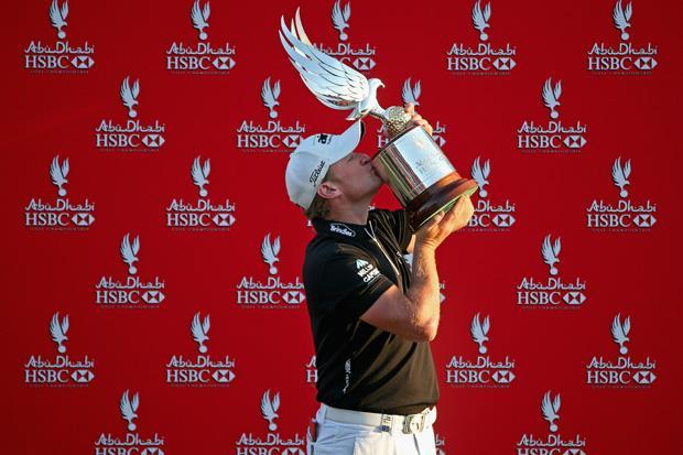 DataFolder/Images/News/02_2013-Abu-Dhabi-HSBC-Golf-Campionship-winner-Jamie-Donaldson-Falcon-Trophy.jpg